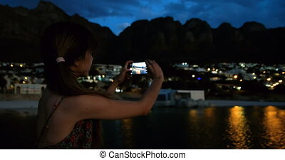 Woman taking picture on on promenade at beach 4k - Beautiful...