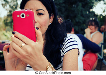 Woman taking picture with her cell phone