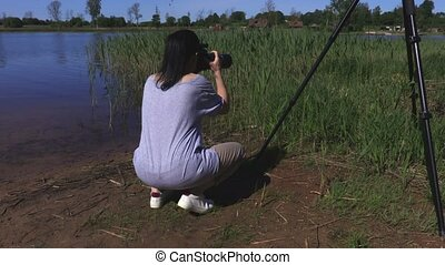 Woman taking pictures at outdoor