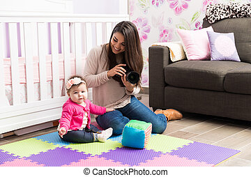 Woman taking pictures of a baby