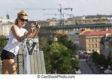 woman taking pictures on her phone