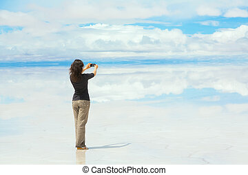 Woman taking pictures on mobile - Woman taking pictures on a...
