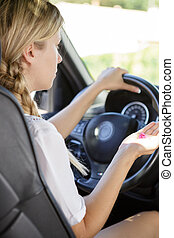 woman taking pills while driving