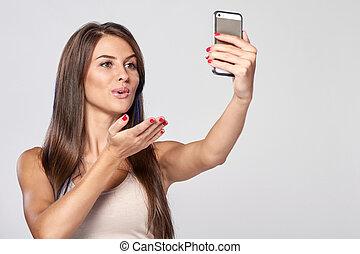 Woman taking self portrait
