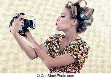 Woman taking Self-portrait - Woman taking self-portrait from...