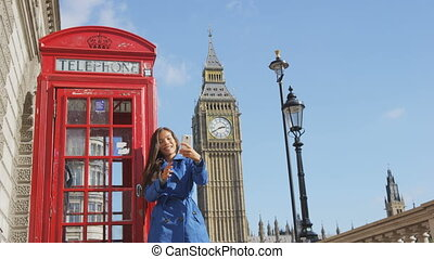 Woman Taking Selfie Against Phonebooth And Big Ben In London England