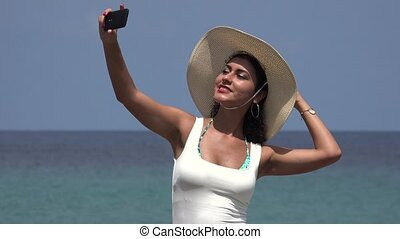 Woman Taking Selfie At Ocean