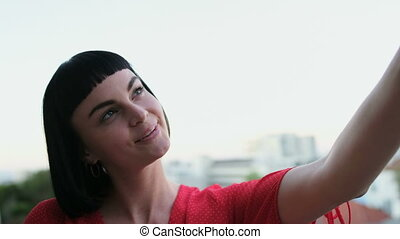Woman taking selfie in balcony at home 4k - Beautiful woman...