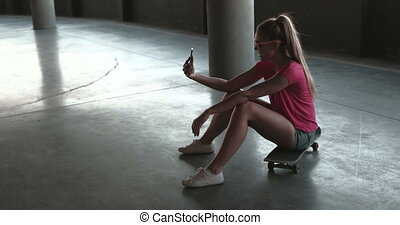 Woman Taking Selfie In Car Park