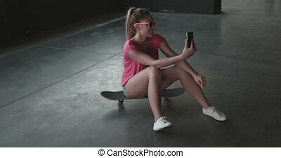 Woman Taking Selfie In Car Park - Attractive young woman...