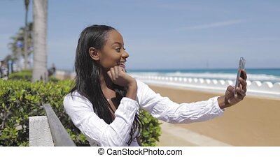 Woman taking selfie on bench - Cheerful young pretty...