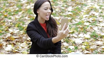 Woman taking selfie on grass