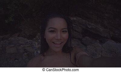 Woman taking selfie on the beach