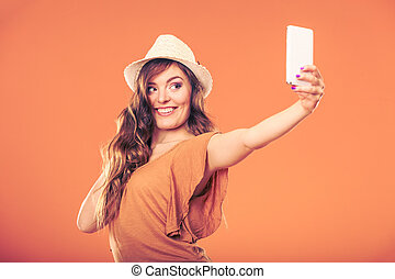 Woman taking selfie self picture with smartphone