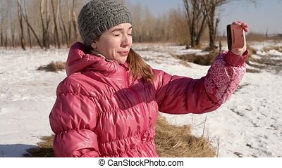 Woman taking selfie with a phone