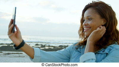 Woman taking selfie with mobile phone 4k