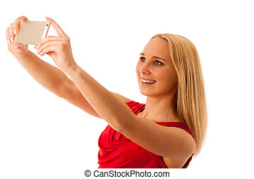 woman taking selfie with smarttphone isolated over white background