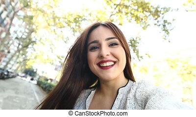 Woman taking selfies in the street slow motion - Happy woman...