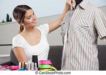 Woman Taking Shirt's Measurement - Young woman taking ...