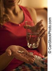 Woman taking sleeping pills
