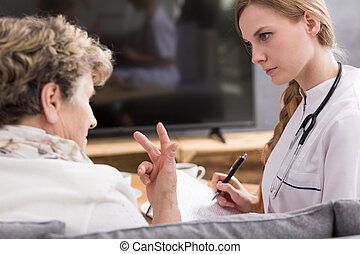 Woman talking about health problem - Senior woman talking...