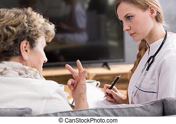 Woman talking about health problem - Senior woman talking...