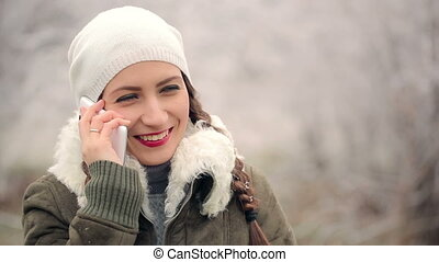 Woman Talking by Phone in Winter Time