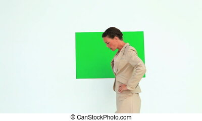 Woman talking in front of a board