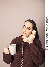 Woman talking on a land line telephone