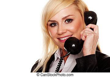 Woman talking on a telephone handset