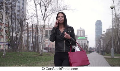 Woman talking on cellphone in the city