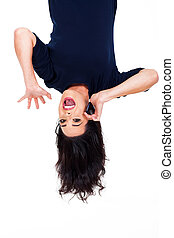 woman talking on cellphone upside down