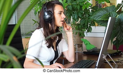 Woman talking on headset in office