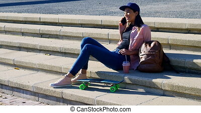 Woman talking on mobile phone in the city 4k