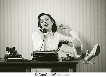 Woman talking on phone at desk - Business woman puts her ...