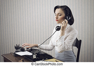 Woman talking on phone at desk