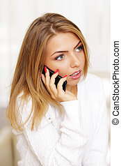 woman talking on phone at home