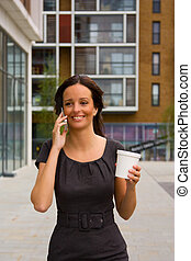 woman talking on phone with coffee.
