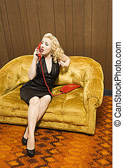 Woman talking on red phone.