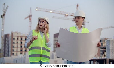 Woman talking on the phone and asks the Builder what is on...