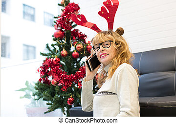 woman talking on the phone at home for christmas