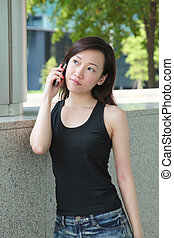 Woman Talking on the Phone - Asian Woman Talking on the...