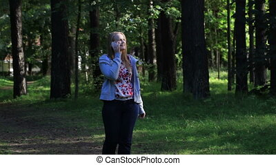Woman talking on the phone in the park.
