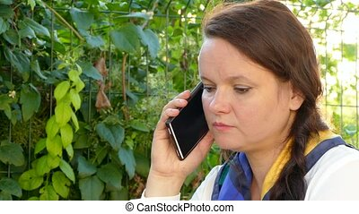 Woman talking on the phone outdoors