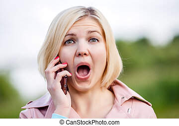 Woman talking on the phone with open-mouth