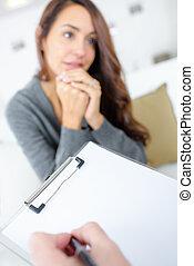 Woman talking to her psychiatrist