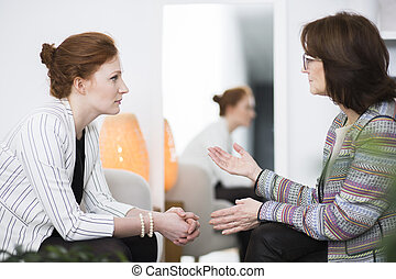 Woman talking to patient