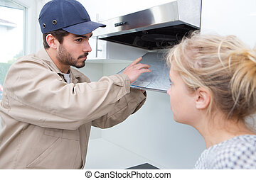 woman talking to worker home