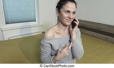 Woman talking untruth on smartphone and holding her fingers....