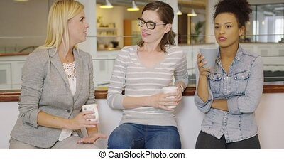 Woman talking with each other during break